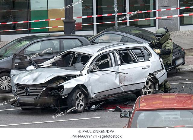 A police bomb disposal expert checks a damaged car, on Bismarckstrasse in Berlin, Germany, 15 March 2016. The driver died when an explosion occurred in the...