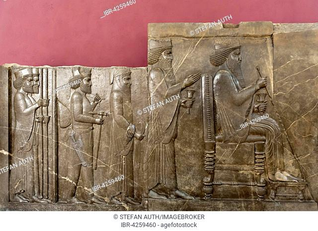 Ancient treasure house relief of the Achaemenids, audience relief of Darius I, seated on the throne, behind crown prince Xerxes I