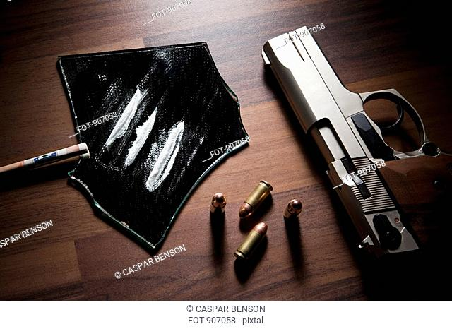 Still Life Of A Handgun, Bullets And Lines Of Cocaine