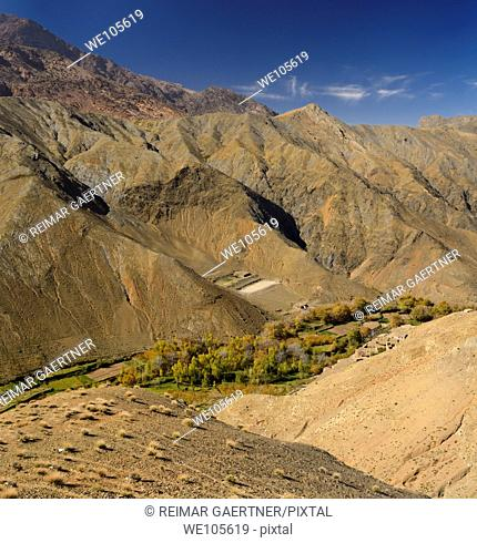 Berber village along a green valley at the Tizi n Tichka Pass over the High Atlas Mountains, Morocco