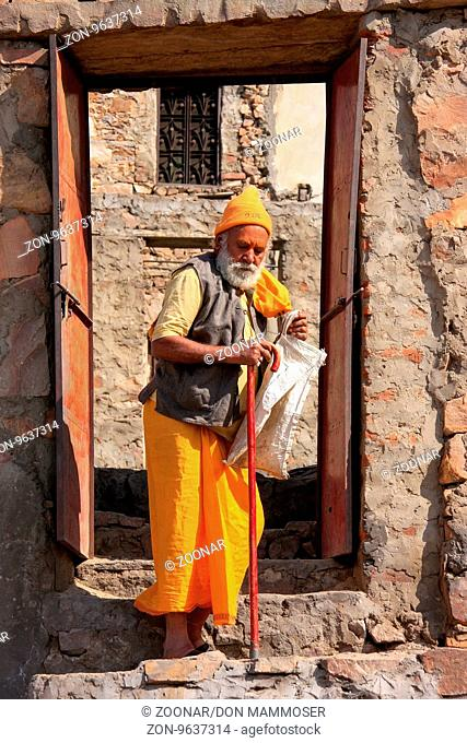 Local man walking to Galta Temple in Jaipur, India. Jaipur is the capital and largest city of the Indian state of Rajasthan