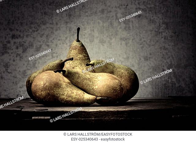 Fruit still life with pears on wooden table. Vintage rustic food image with artistic texture effect