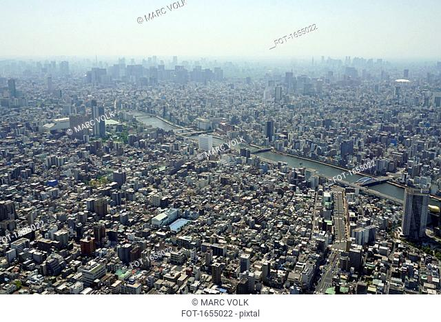 Aerial view of cityscape against sky on sunny day, Tokyo, Japan