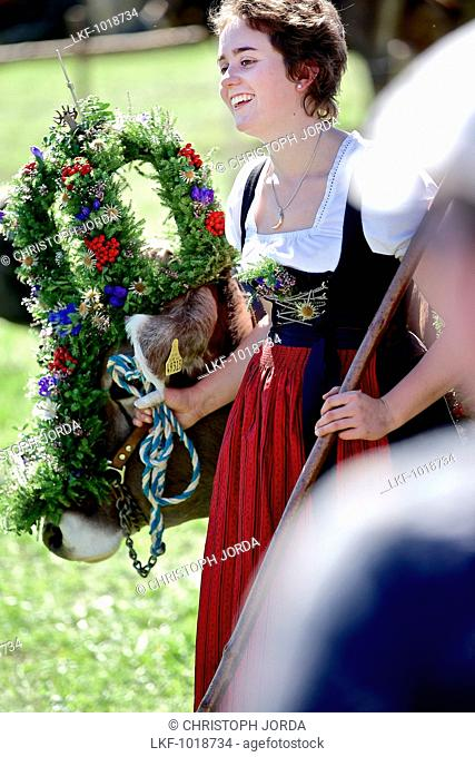 Woman wearing a dirndl with a decorated cattle, Viehscheid, Allgau, Bavaria, Germany