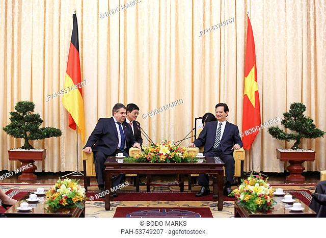 GermanMinister for Economic Affairs and Energy, Sigmar Gabriel (L, SPD) and Prime Minister of Vietnam Nguyen Tan Dung (R) and their interpreters meet for...