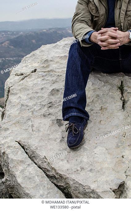 Man sat on the rock