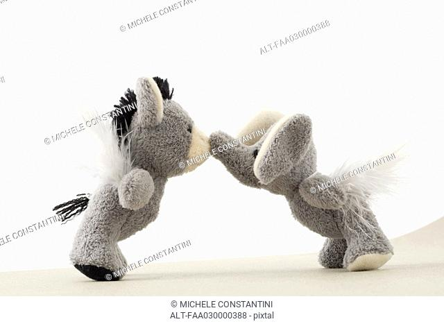 Stuffed toys face to face, touching noses