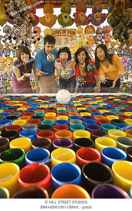 People playing with a fairground attraction