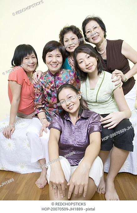 Portrait of a group of women posing and smiling