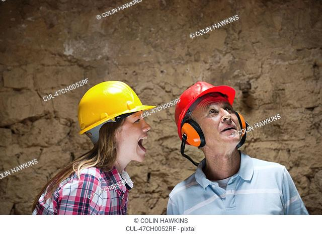 Construction worker yelling at colleague