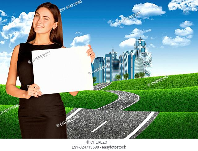 Businesswoman holding paper sheet. Road leading to business center