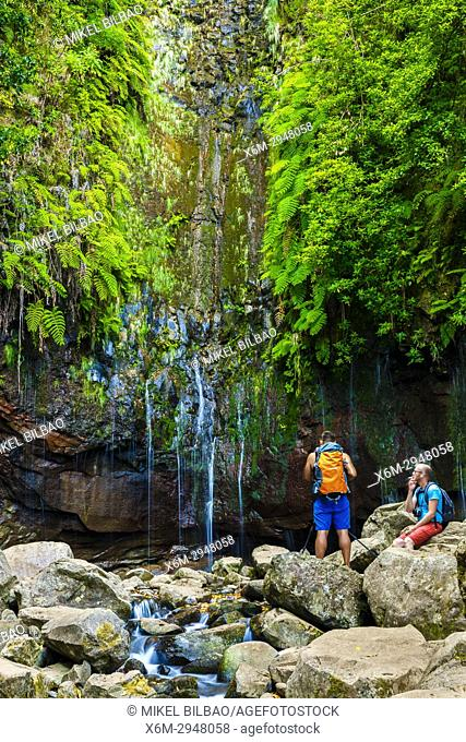 People in a canyon. Levada das 25 Fontes route. Madeira, Portugal, Europe