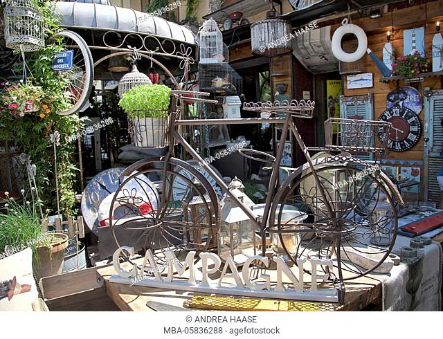Flea market in L'Isle-sur-la-Sorgue, an antique village in Provence, France