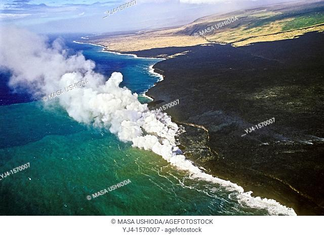 aerial view of lava ocean entry showing lava delta and bench - hot molten lava fed from multiple underground lava tubes, creating massive steam clouds as it...