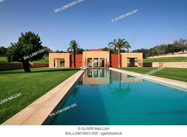 Swimming pool with Mediterranean style pool house