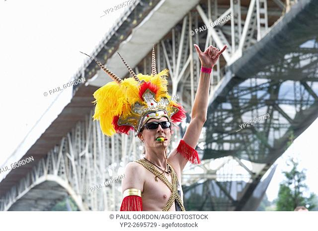 Seattle, Washington: Band Leader at the Summer Solstice Parade and Festival. The annual event is produced by the Fremont Arts Council