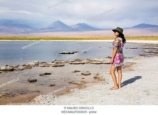 Chile, San Pedro de Atacama, woman standing in the desert at lakeside