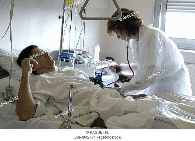MAN HOSPITAL PATIENT W. NURSE<BR>Photo essay from hospital. Patient and nurse.<BR>Hospital of Reims, in the French region of Champagne-Ardenne