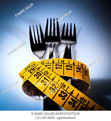 Forks and measuring tape. Concept of food and weight loss