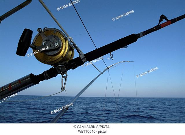 Fishing rods onboard a boat in the Mediterranean Sea, France