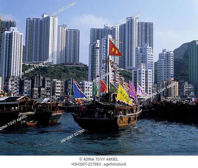 Hong Kong. Aberdeen harbour. Sampans and apartment buildings