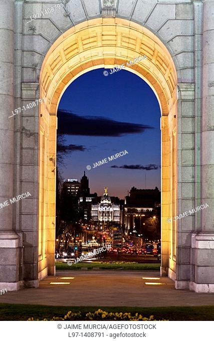 Night time view towards the Gran Via in Madrid through The historic Puerta de Alcalá  monument