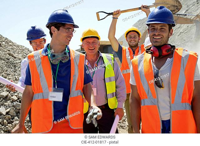 Workers smiling together in quarry