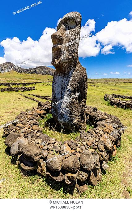 Single moai statue guards the entrance at the 15 moai restored ceremonial site of Ahu Tongariki on Easter Island (Isla de Pascua) (Rapa Nui)