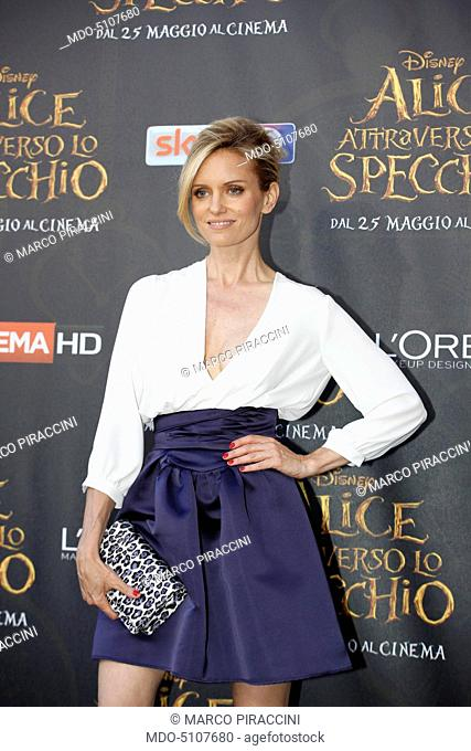 American showgirl and TV presenter Justine Mattera (Justine Elizabeth Mattera) posing on the red carpet at the national premiere of the film Alice Through the...