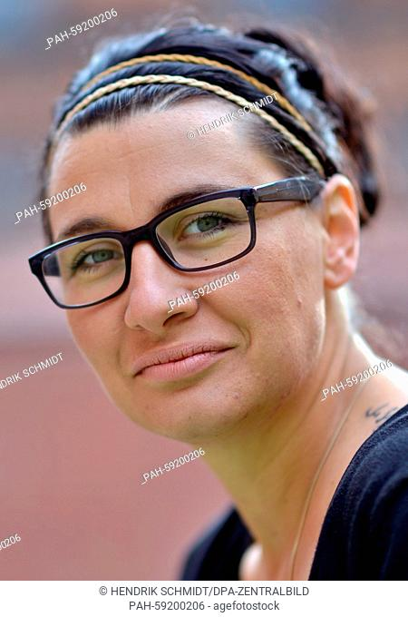 Student teacher Julia Rueprich poses in the courtyard of a juvenile detention centre in Halle, Germany, 27 May 2015. She has been teaching there once a week...